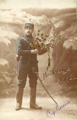Beeld- en postzijde nieuwjaarskaart, soldaat met hulst- en maretak, 1915